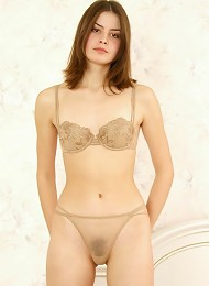 Lovely teen girl posing naked on the bed